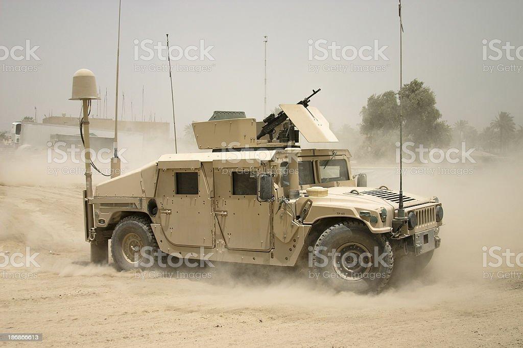 Moving Humvee stock photo