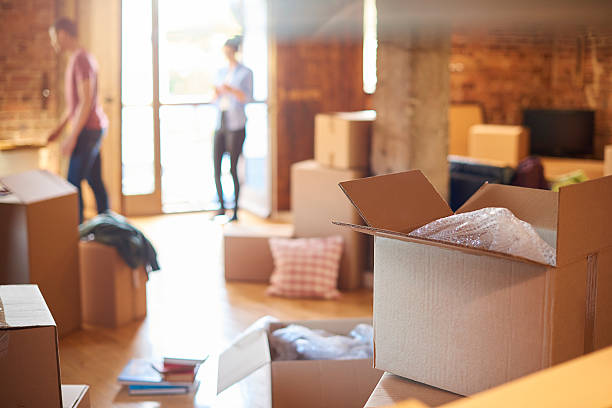 moving in box - relocation stock photos and pictures