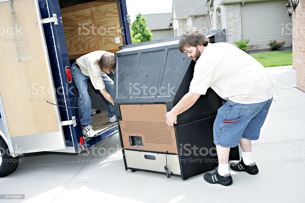 Moving Large Television stock photo