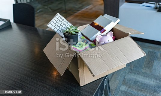 Moving office and packing belongings in a box or getting fired