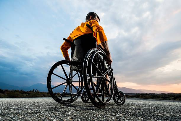 moving on Man in s wheelchair pondering life  paralysis stock pictures, royalty-free photos & images