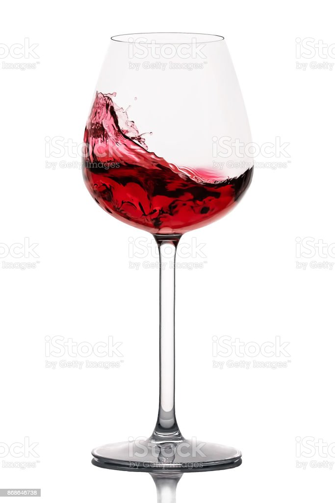 moving red wine glass over a white background stock photo