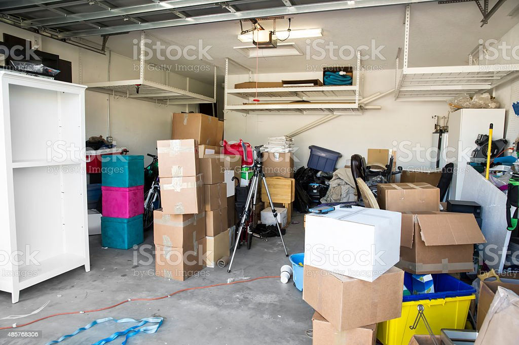 Moving Series: Garage full of cartons and belongings for move stock photo