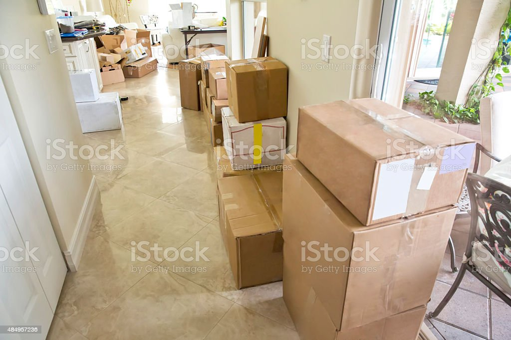 Moving Series: Packed boxes line hallway of home for moving stock photo
