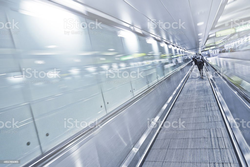 Moving sidewalks in airport stock photo