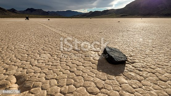istock Moving stone in the desert of Death Valley national park, California. 646907754