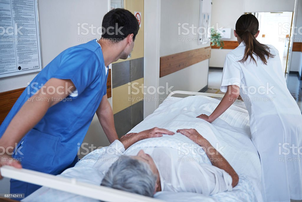Moving the patient to her ward stock photo