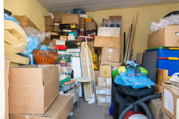 Moving, things packed in boxes and packages lie in a small room stock photo