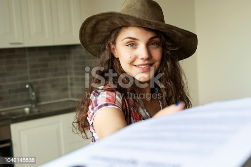 Young woman student moving into a new home