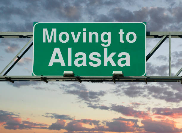 moving to alaska sign - alaska us state stock photos and pictures