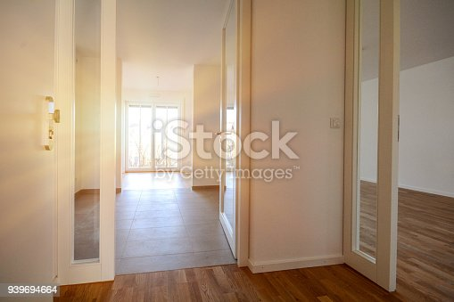 istock Moving to new apartment, entry to modern empty home in a residential building 939694664