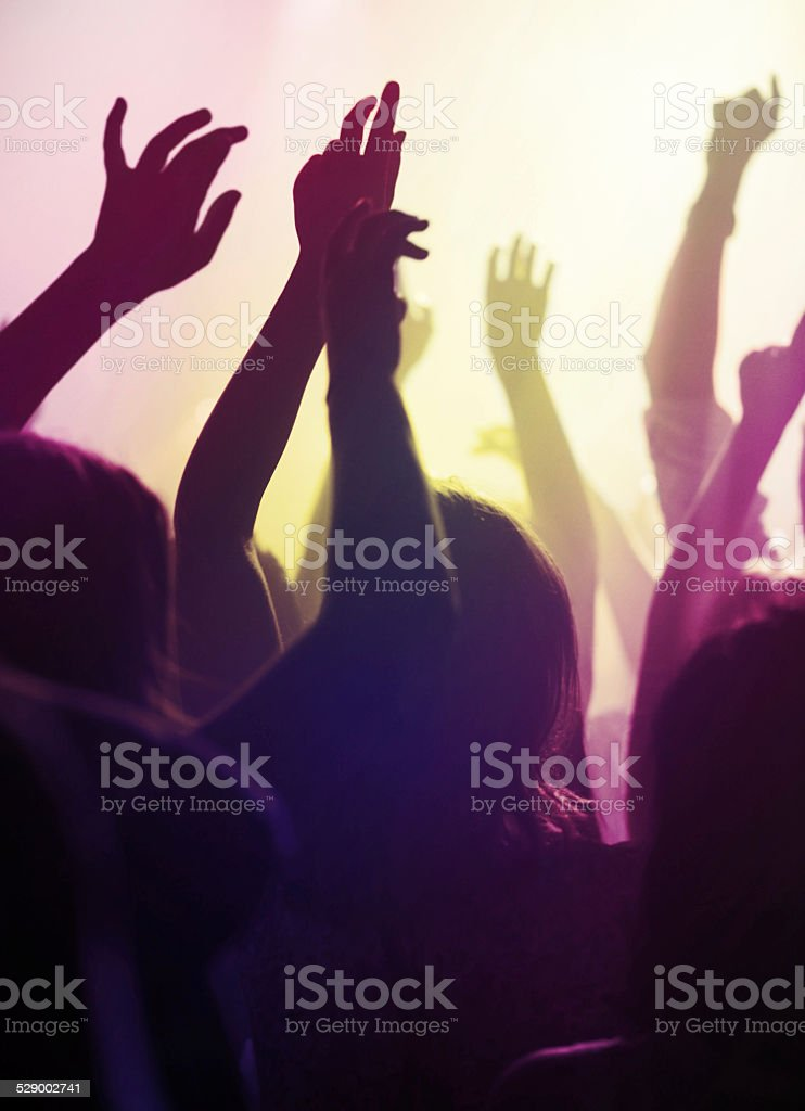 Moving to the music of their favourite band stock photo