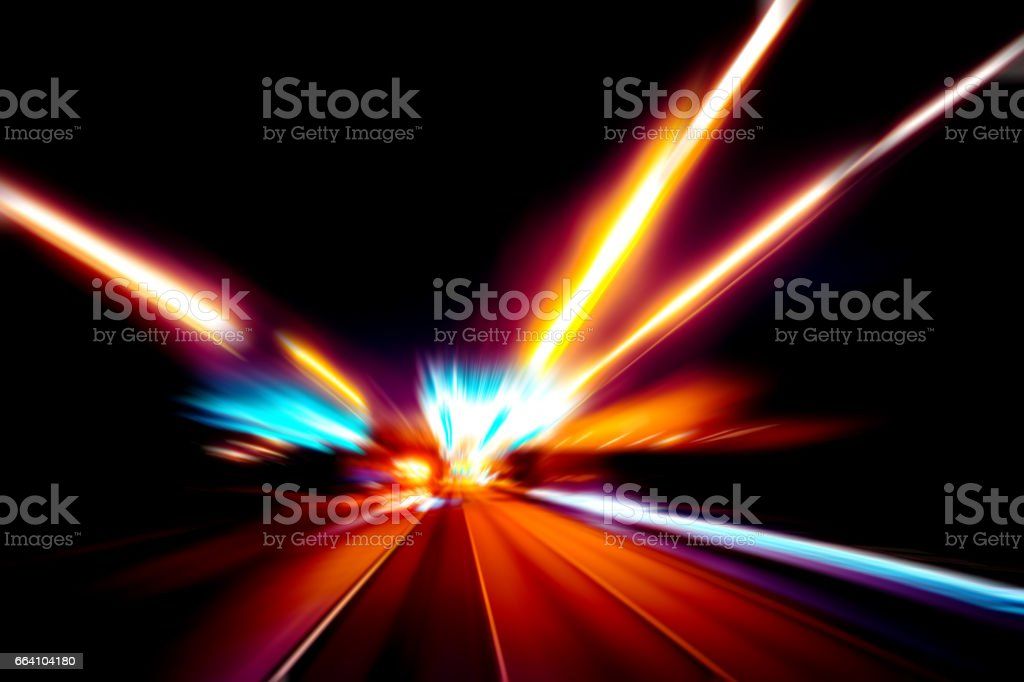 moving traffic light trails at night / Abstract image of night traffic light in the city foto stock royalty-free