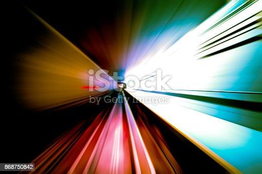 824108398istockphoto moving traffic light trails at night 868750842