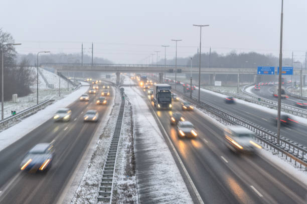 Moving traffic on a highway during a snow blizzard in winter stock photo