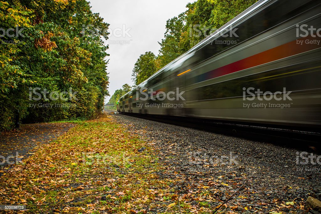 Moving train in the fall stock photo