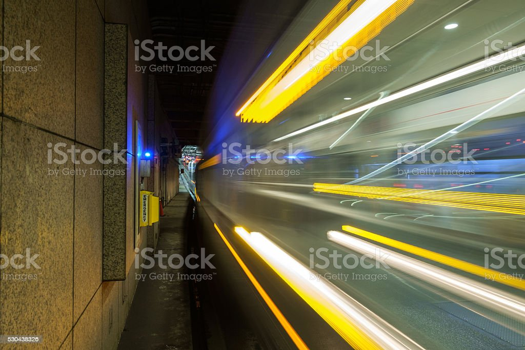 Moving train in transit tunnel stock photo