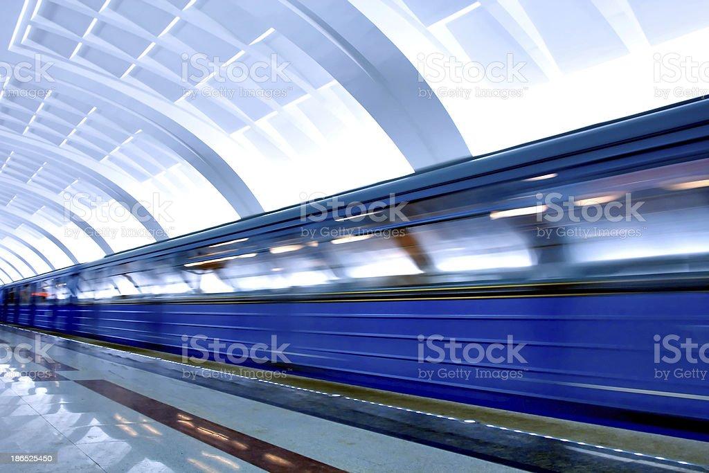 Moving train on underground station royalty-free stock photo