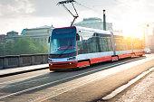 Red modern tram in Prague, Czech Republic.