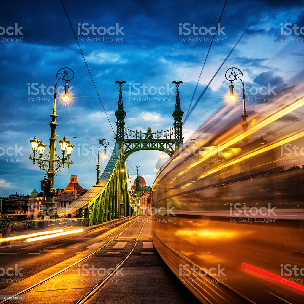 Moving Trams on Liberty Bridge, Budapest stock photo