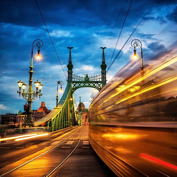 Moving Trams on Liberty Bridge, Budapest Moving Trams on Margaret Bridge, Budapest liberty bridge budapest stock pictures, royalty-free photos & images
