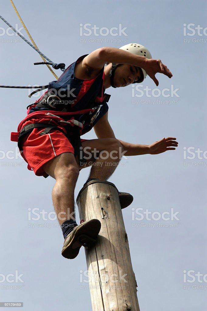 Climbing on high beam in Adrenaline Park.