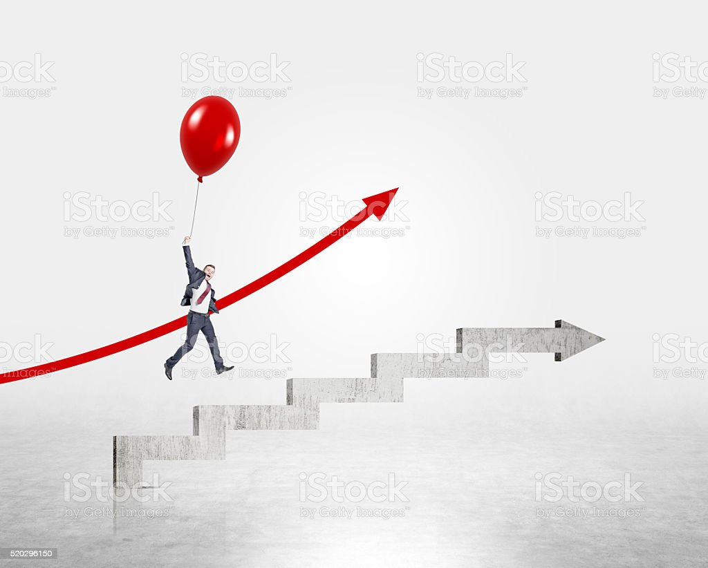 Businessman flying up on red balloon over stairs shaped by concrete...