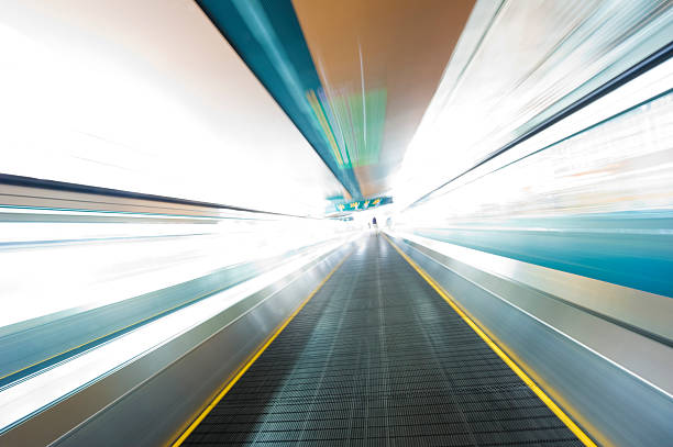 moving walkway abstract - perpetual motion stock photos and pictures