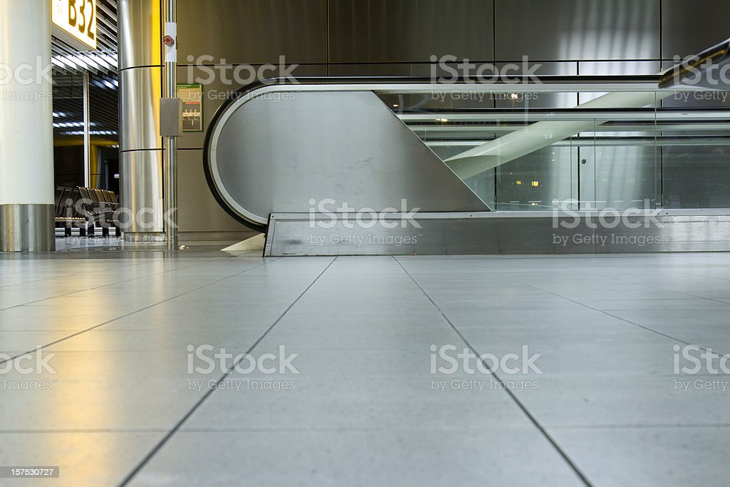 Moving walkway at an airport waiting area stock photo