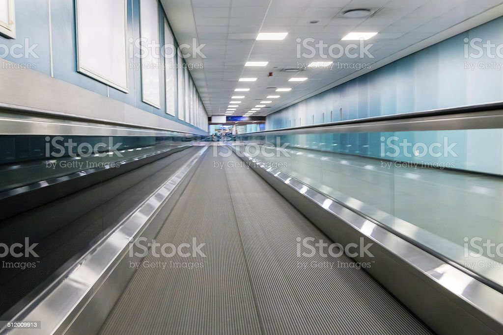 Moving walkway at the airport stock photo