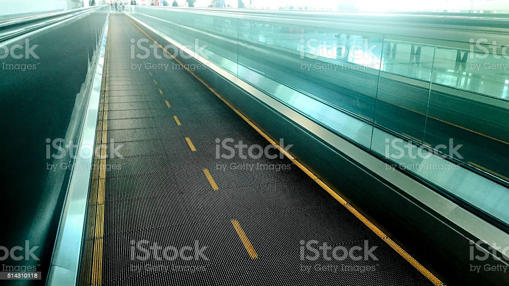 Moving walkway in departure lounge stock photo
