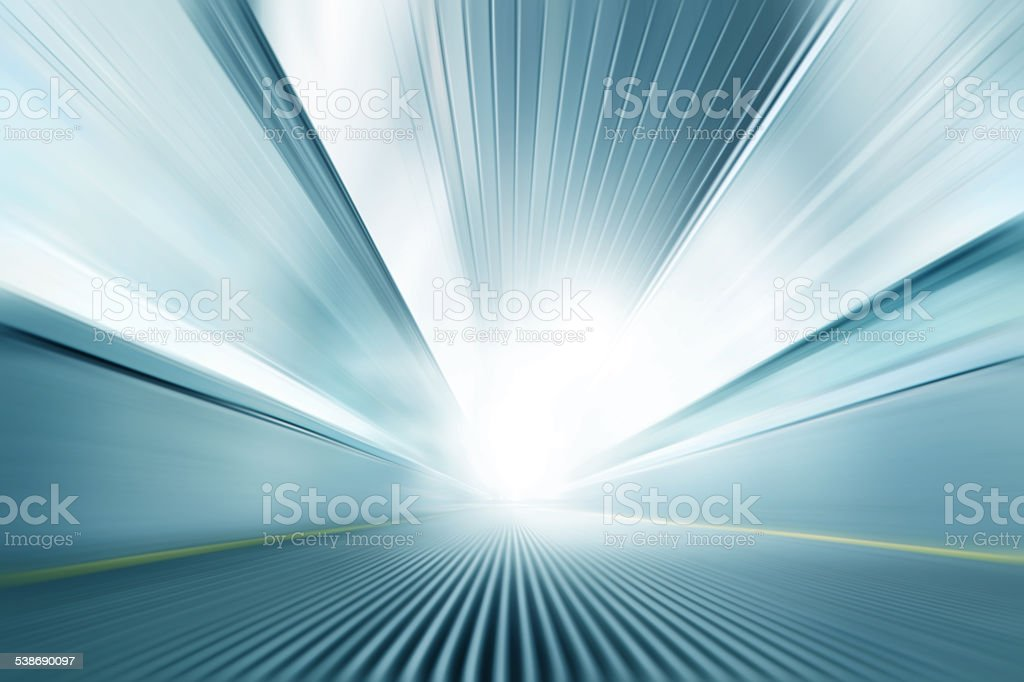 Moving walkway in motion blur. stock photo