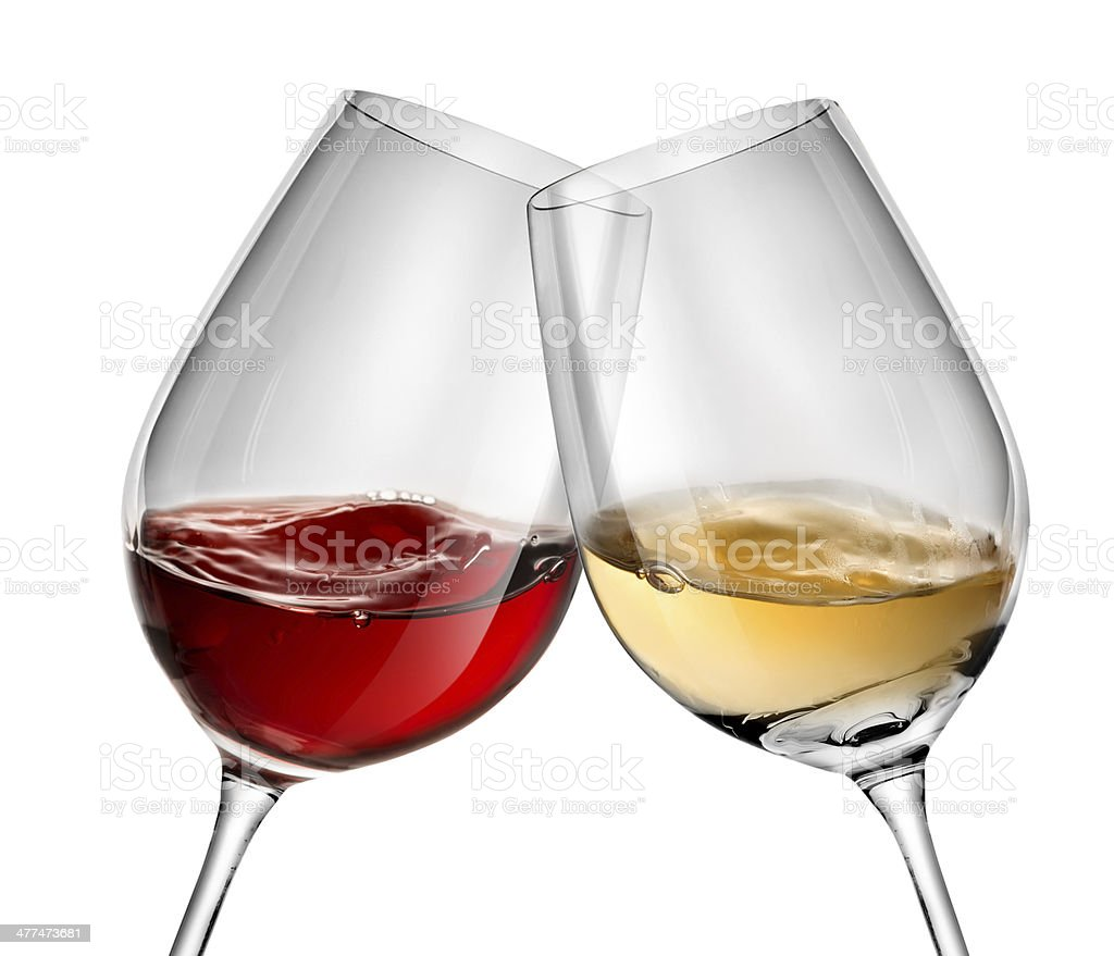 Moving wine in two wineglasses stock photo