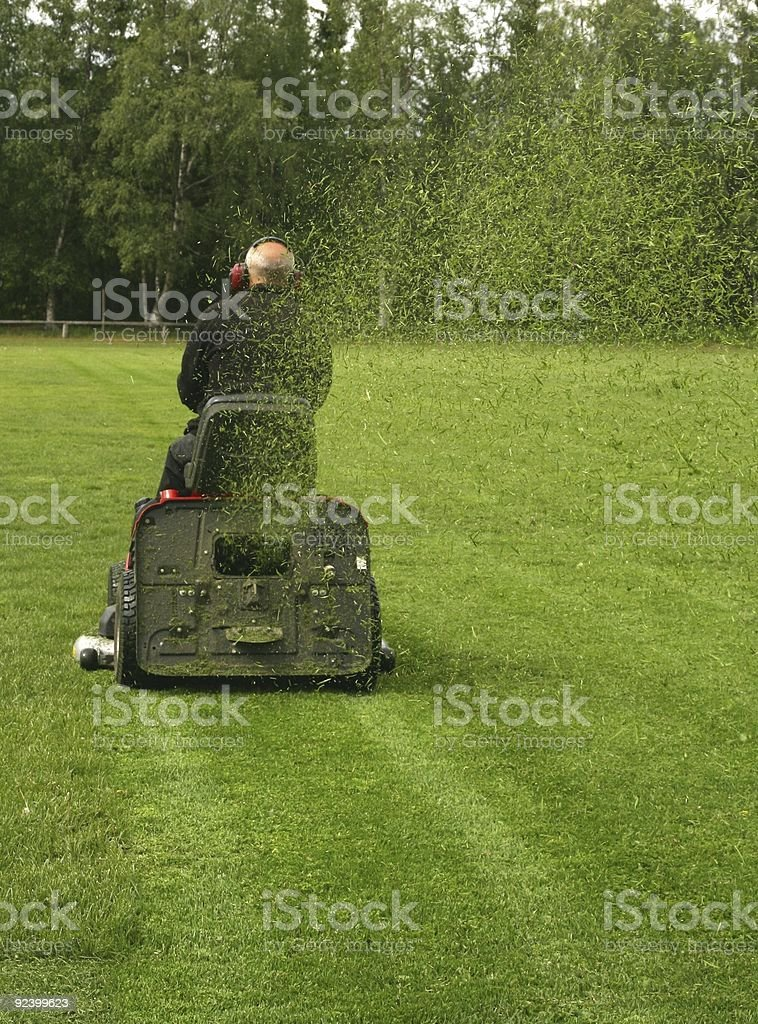 Mowing soccer field stock photo
