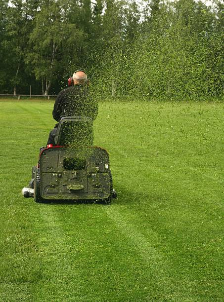 mowing soccer field - riding lawn mower stock photos and pictures