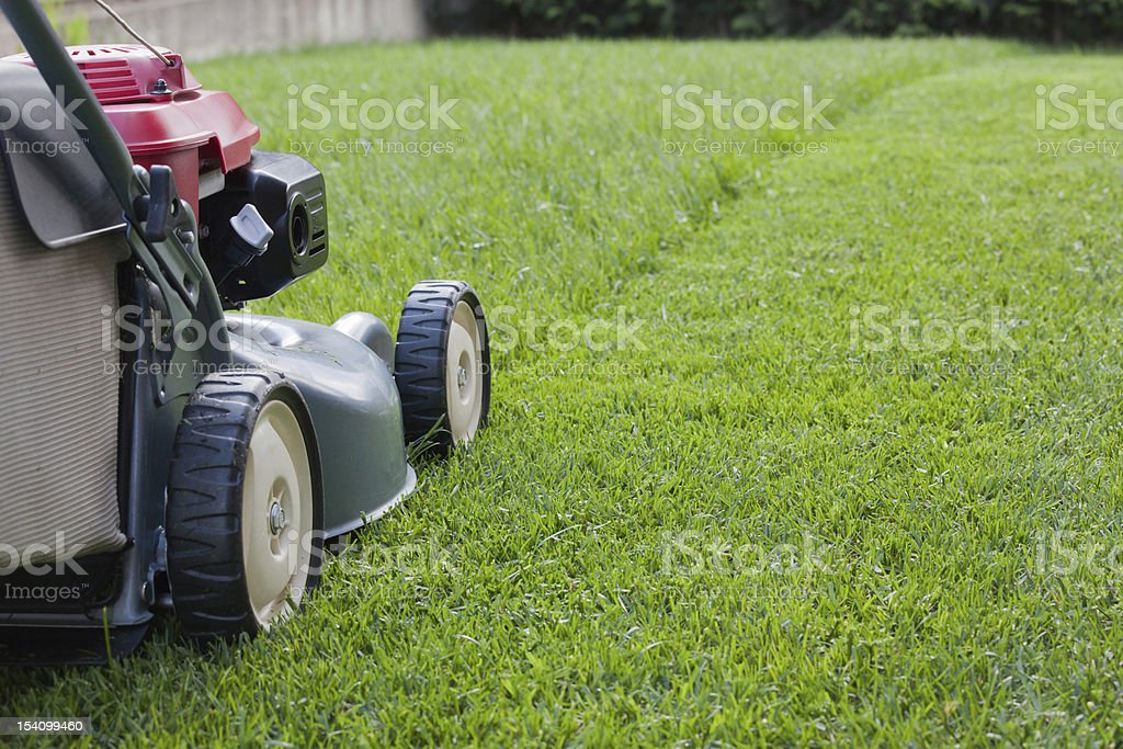 Mowing the grass stock photo