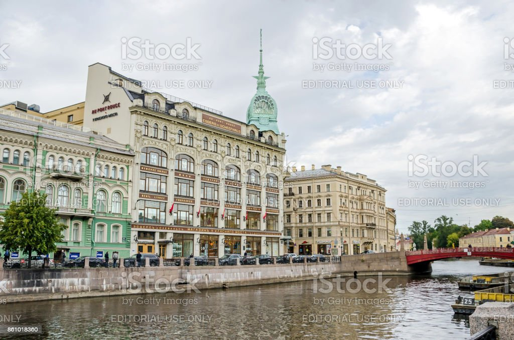 Moyka River with the Red Bridge and the department store Au Pont Rouge in Saint Petersburg, Russia stock photo