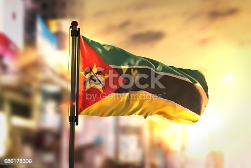 istock Mozambique Flag Against City Blurred Background At Sunrise Backlight 686178306