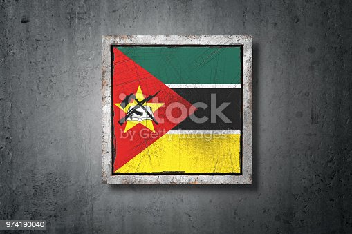 istock Mozambique flag in concrete wall 974190040