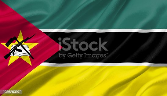 istock Mozambique flag waving with the wind, 3D illustration. 1056263972