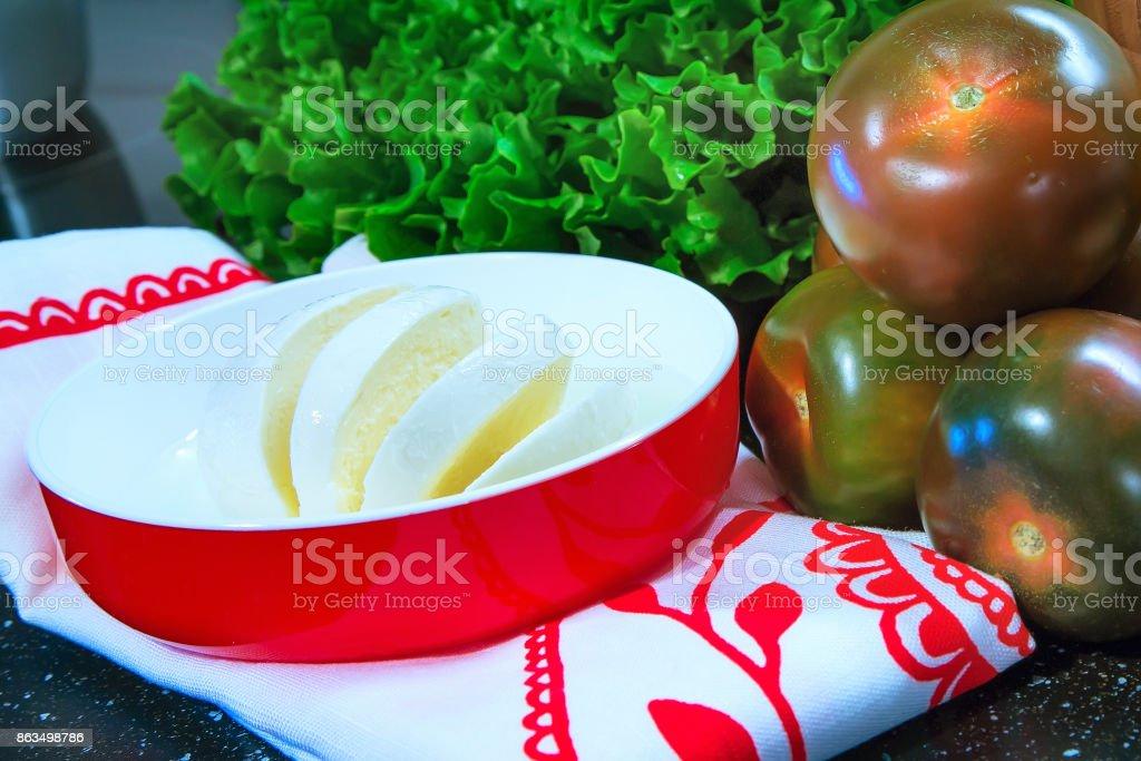 Mozarella with tomatoes, lattuce stock photo
