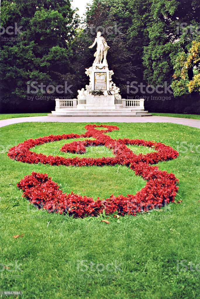 Mozart's Statue in Vienna with treble clef royalty-free stock photo