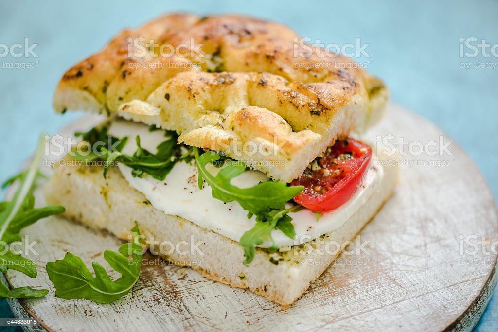 mozzarella and tomato sandwich stock photo