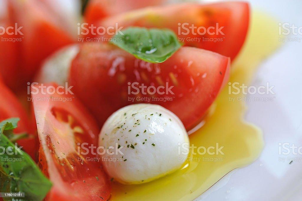 Mozzarella Bowl in Tomato Salad Close-Up royalty-free stock photo