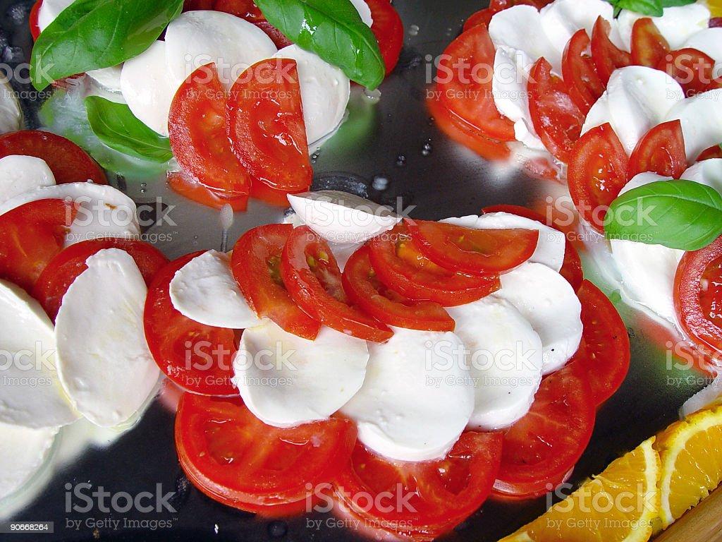 Mozzarella cheese and tomatos royalty-free stock photo