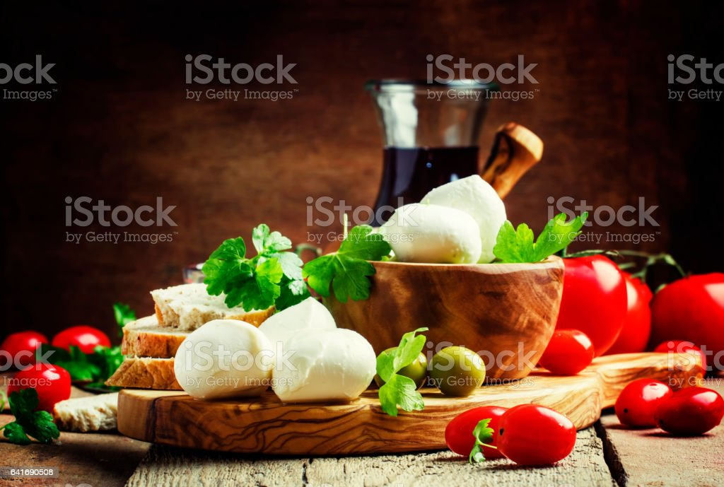 Mozzarella cheese, bread, olives and tomatoes, snack plate stock photo