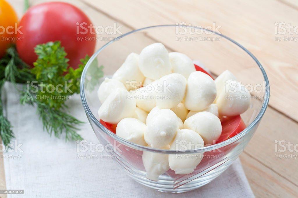 Mozzarella cheese in a glass bowl royalty-free stock photo