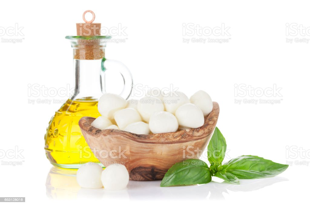 Mozzarella cheese, olive oil and basil stock photo