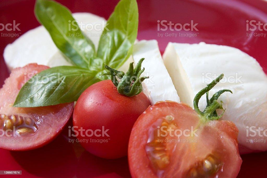 Mozzarella cheese salad on red stock photo