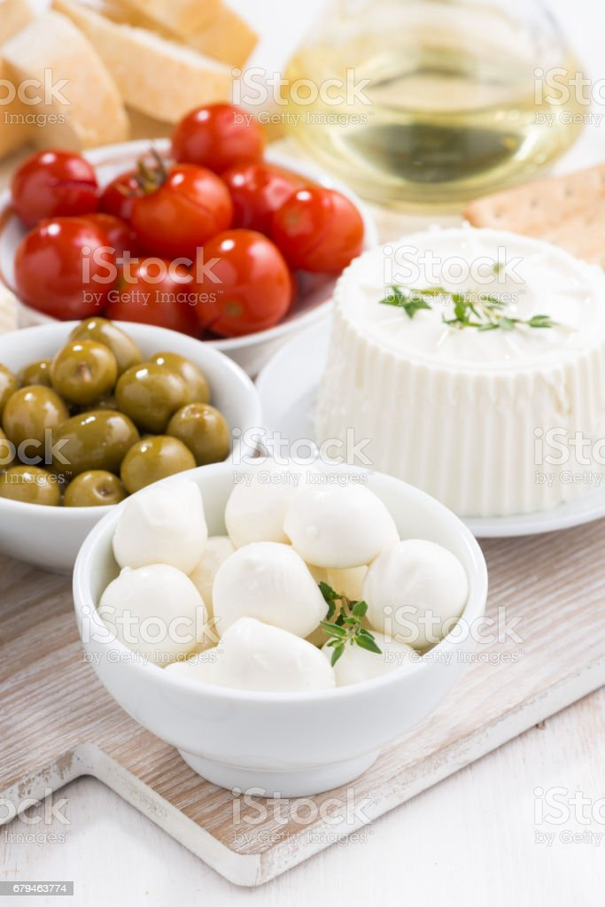 mozzarella, cream cheese and pickles, vertical royalty-free stock photo